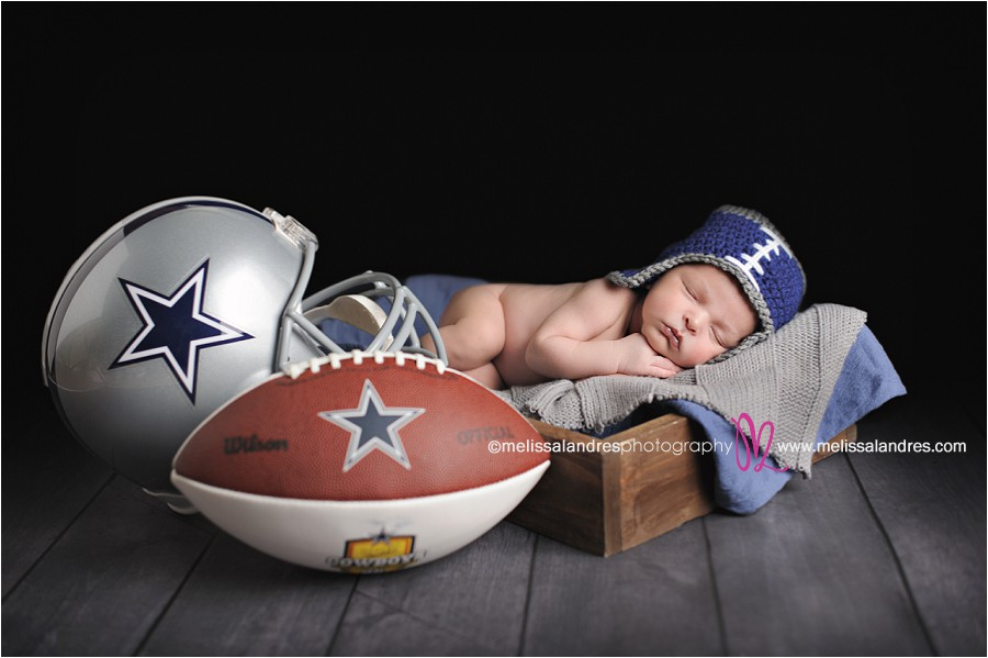 Baby photos with football and helmet by indio newborn photographer melissa landres