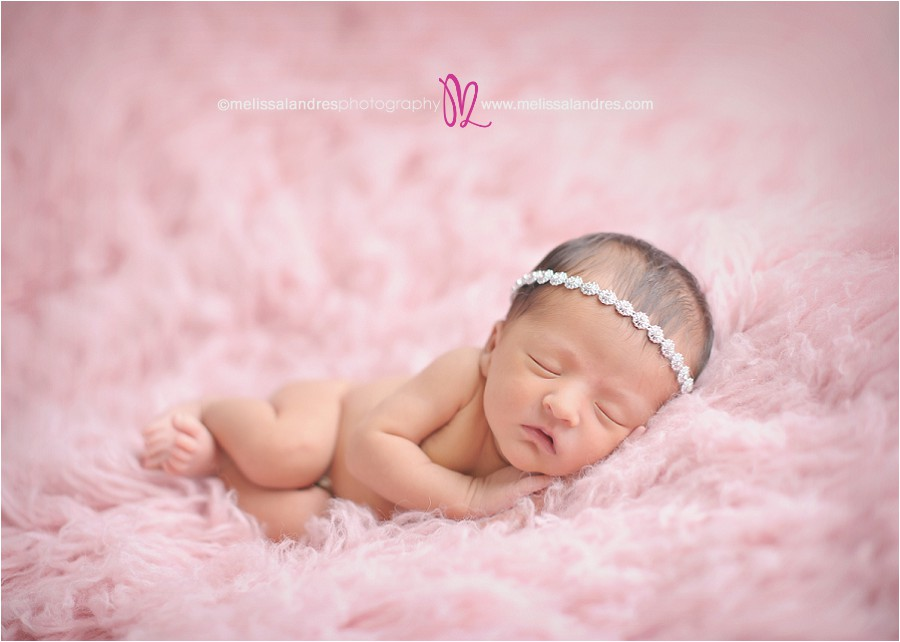 Professional newborn baby pictures cute baby girl with rhinestone headband